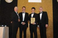 brian-yip-collecting-his-gold-medal-award