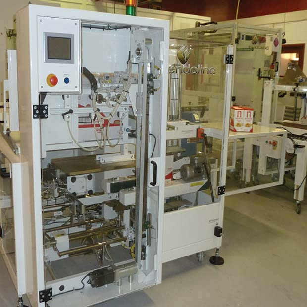 The-Endoline-case-erector-forms-and-seals-up-to-30-shelf-ready-cases-per-minute-using-a-hot-melt-glue