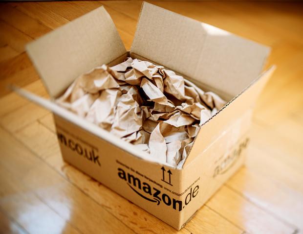 bigstock-Amazon-Parcel-Opened-On-Home-P-82975889