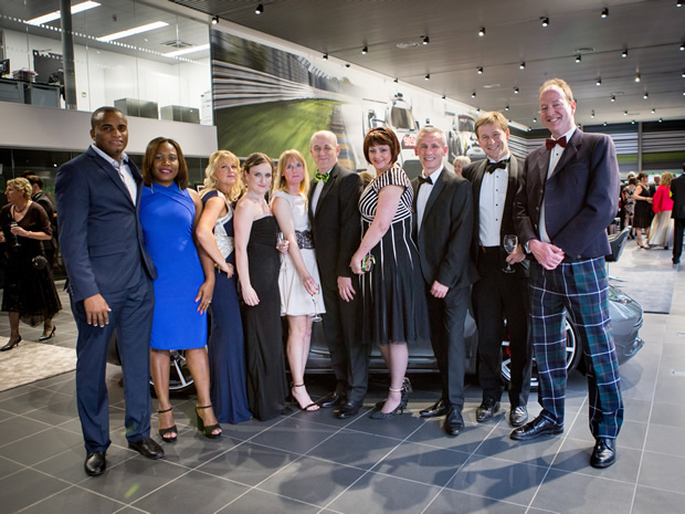 Grace Foods Managing Director Adam Reader (centre), celebrates a hat-trick of Herts Chamber of Commerce awards with colleagues.